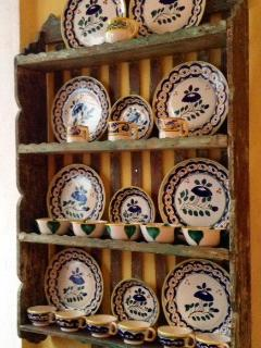 Mexican plates on antique plate rack