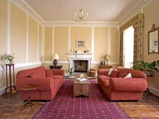 Comfortable, squashy sofas in the drawing room, perfect for relaxing.