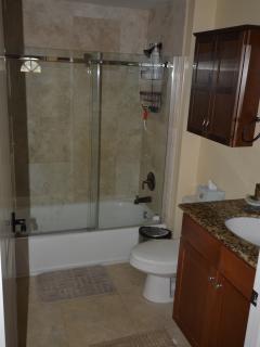 Bathroom with Shower door and storage