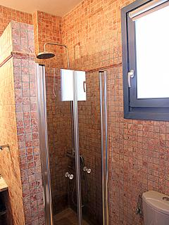 Master Bathroom 1 with walk in rain shower at the lower level