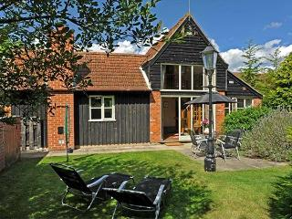 WOODMAN'S COTTAGE, detached, two bedrooms with en-suites, enclosed lawned garden