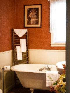 The bath contains a vintage 1917 claw foot tub for your relaxation.