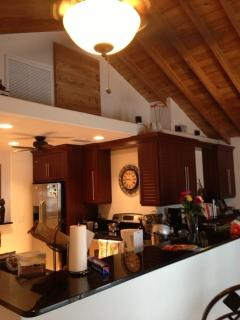 Custom kitchen with granite counters, is located under the original florida pine ceiling.