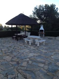 Communal grill area beside the pool.