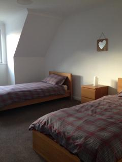 One of the upstairs twin rooms