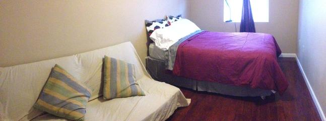Bedroom 1 with full size bed and a futon
