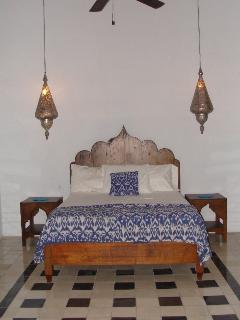 Fabulous Moroccan bed and lights.