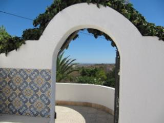 Arch leading out the pool area.