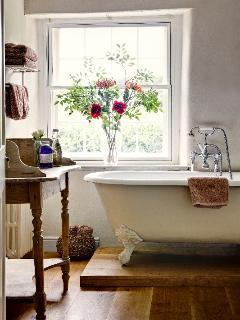 Bathroom with free standing roll top bath