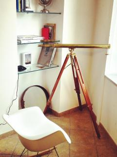 Relaxing corner with an original telescope a rocking chair and a great view!