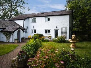 RHOS Y BEL, semi-detached farmhouse, woodburner, off road parking, front and