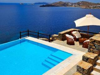 Waterfront Hermes with dazzling sea views, infinity pool, helipad & dock access, Tourlos