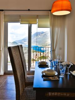 Inside dining area with marina and mountain views.