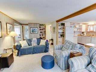 Your dog will love exploring the woods and warming by the fire at this cottage, Beaverton