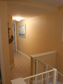 UPSTAIRS HALLWAY TO ROOMS AND BATHROOM
