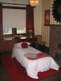 A comfortable fold out bed can be set up in the Dining room as a private room for a fifth guest
