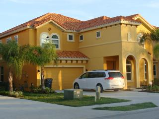 An impressive Tuscan style villa, landscaped with palm trees. Florida Delight welcomes you!