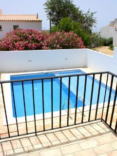 The sunny patio off the twin bedrooms has new railings with a gate and steps to the pool area
