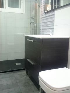 Newly refurbished bathroom 2015 with shower and mirrored vanity unit