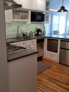 Kitchen has gas cooktop, range hood, Dishwasher, garbage disposal, etc.