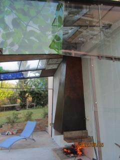 fireplace under the glass veranda