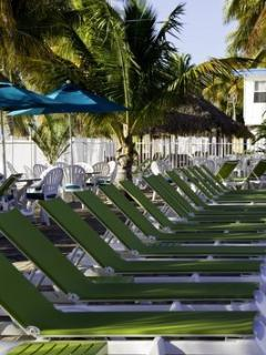 Cabana Club- Plenty of comfy sling lounge chairs provided for your convenience