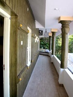 Private entrance to each room, with shared outdoor sitting area