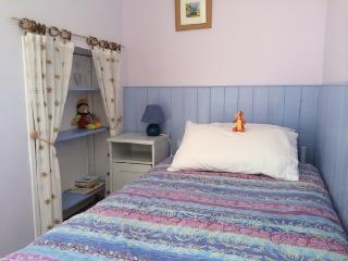 One of the single beds in the twin room