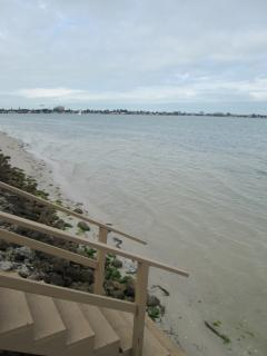 Steps down from pool to swim in salt water Boca Ciega Bay(tide in pic)up to40 ft beach tide out