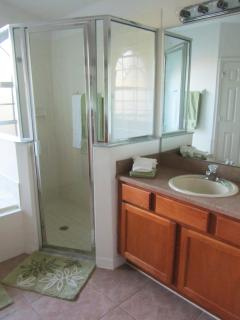 Large walk in shower and His and Hers sinks in Master Bathroom
