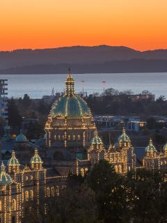 Sunset over the BC Legislature and the western hills, as seen from your private balcony