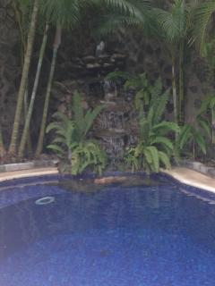 Private pool with a flowing waterfall, always at the perfect temperature, freely heated by the Sun
