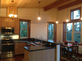 The open kitchen allows you to visit with others and enjoy the wonderful view.