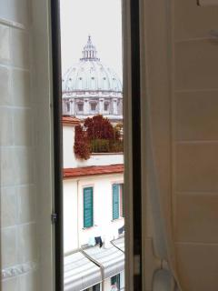 View of St. Peter's dome from the window of the bathroom
