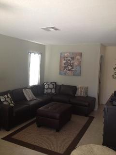 Family room with sectional sofa and 50' TV