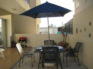 patio area with BBQ and dist sea view