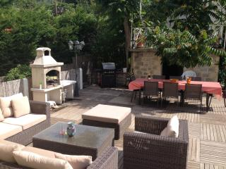 Decked summer salon, dining table and 2 BBQ's (traditional and gas).
