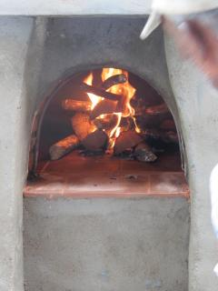 Enjoy cooking in our wood fired pizza oven