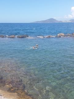 Right by the restaurant you can take a dip in the crystal clear sea - one of our favourites!
