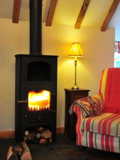 What more could you want - relaxing by the wood-burning stove enjoying a lovely night in.