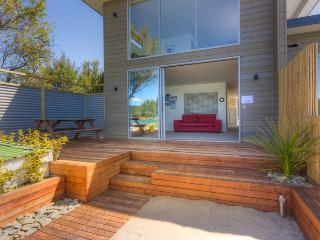 "Breakfast on the deck in the morning sun!  ""Personal Beach"" leads down to beach, estuary and wharf,"