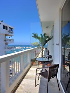 A locked glass door separates your terrace while maintaining the view.