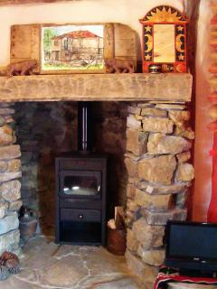 Log burner fire with gifted painting by a guest.