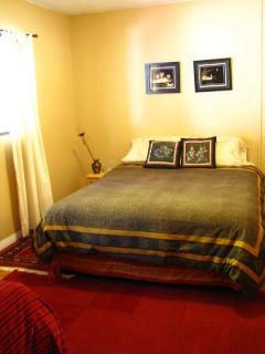 Deluxe suite with queen and double bed.