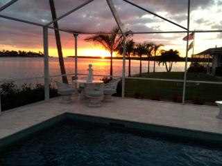 WATCH THE DOLPHINS! LUXURY HOME WITH LARGE POOL AND WIDE WATER VIEW!
