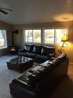 Family room is a great place to gather on leather couches and warm fire place.