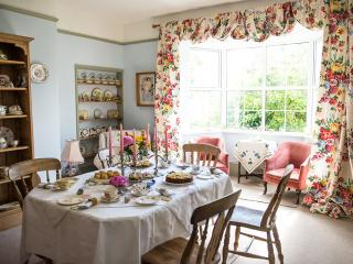 The dining room set up for a vintage tea party