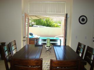 dining area seats 8 with french doors to the pool