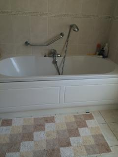 Large deep bath with fitted shower attachement in main bathroom