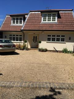 Large house on the edge of Chobham Common in a leafy lane. Great for families, golfers & London.